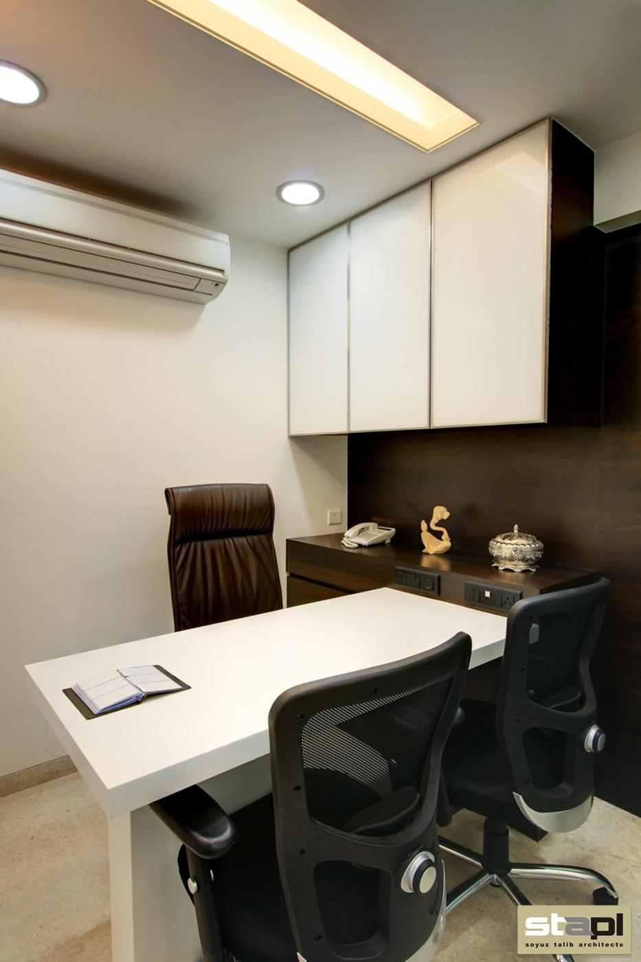 Siddhi vinayak construction soyuz talib architects for Small office cabin interior design ideas